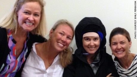 Emily Ferguson wears a cold cap during one of her treatments, surrounded by the friends who helped her through it.