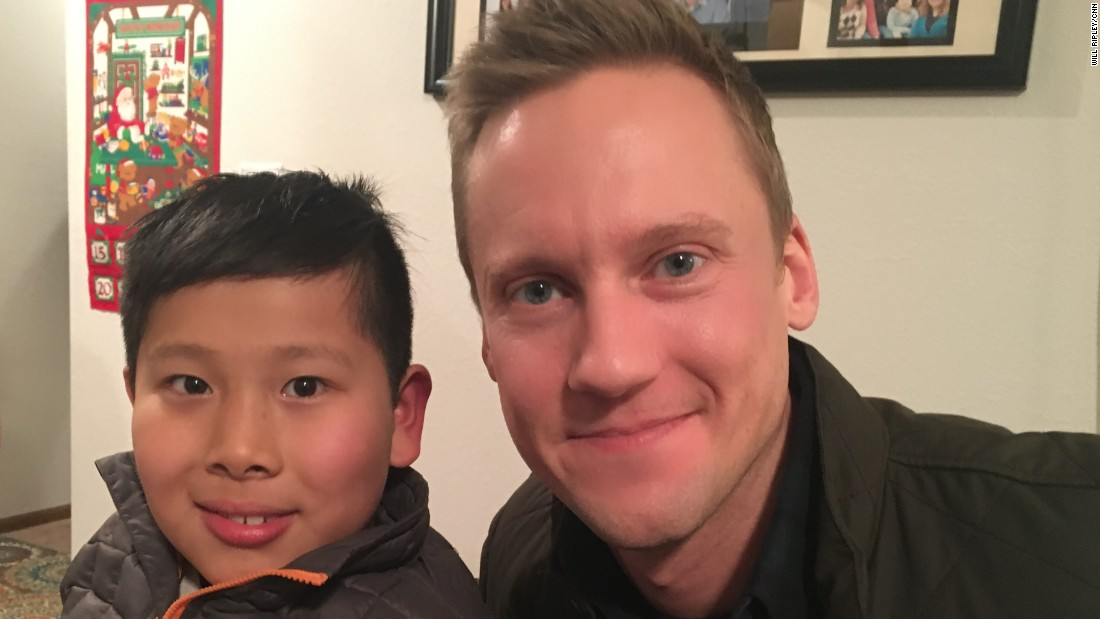 Jason and CNN's Will Ripley photographed on December 9, 2016. Ripley's report on Alenah's children's home in Beijing led to Jason's adoption.