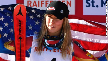 US skier Mikaela Shiffrin waves a US flag as she celebrates her second place after  the women's giant slalom race at the 2017 FIS Alpine World Ski Championships in St Moritz on February 16, 2017.