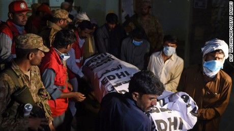 Pakistani volunteers carry the body of a victim from a hospital in the town of Sehwan, a day after a bomb attack hit the 13th century Muslim Sufi shrine of Lal Shahbaz Qalandar in Sindh province, some 200 kilometres northeast of the provincial capital Karachi, on February 17, 2017. At least 70 people were killed and hundreds wounded Thursday when a bomb ripped through a revered Sufi shrine in southern Pakistan, officials said, after a series of attacks which have shaken optimism over recent improvements in security. The Islamic State group (IS) claimed the attack, the deadliest to hit Pakistan so far in 2017. / AFP / ASIF HASSAN        (Photo credit should read ASIF HASSAN/AFP/Getty Images)