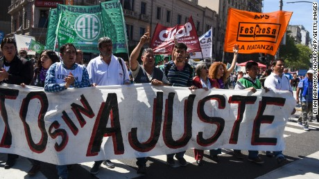 State workers demonstrate outside the National Congress in Buenos Aires, on September 27, 2016, during a national strike by civil servants, teachers and health workers asking for the reopening of wage negotiations to compensate inflation that exceeds 40% annually. Argentine President Mauricio Macri came to power with a flurry of reforms, slashing import and export taxes, announcing subsidy cuts for electricity and natural gas, and ending currency controls -- which triggered a sharp devaluation of the peso and fueled inflation. / AFP / EITAN ABRAMOVICH        (Photo credit should read EITAN ABRAMOVICH/AFP/Getty Images)