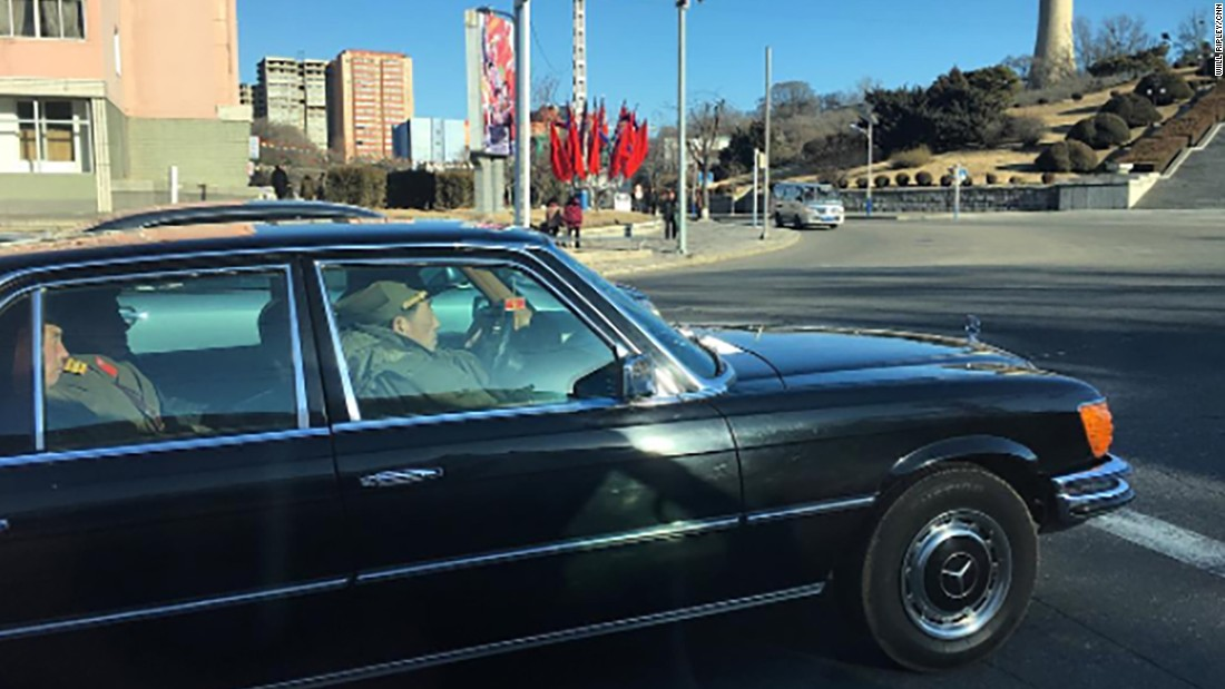 North Korean soldiers ride in a black Mercedes-Benz on the streets of Pyongyang on February 17.