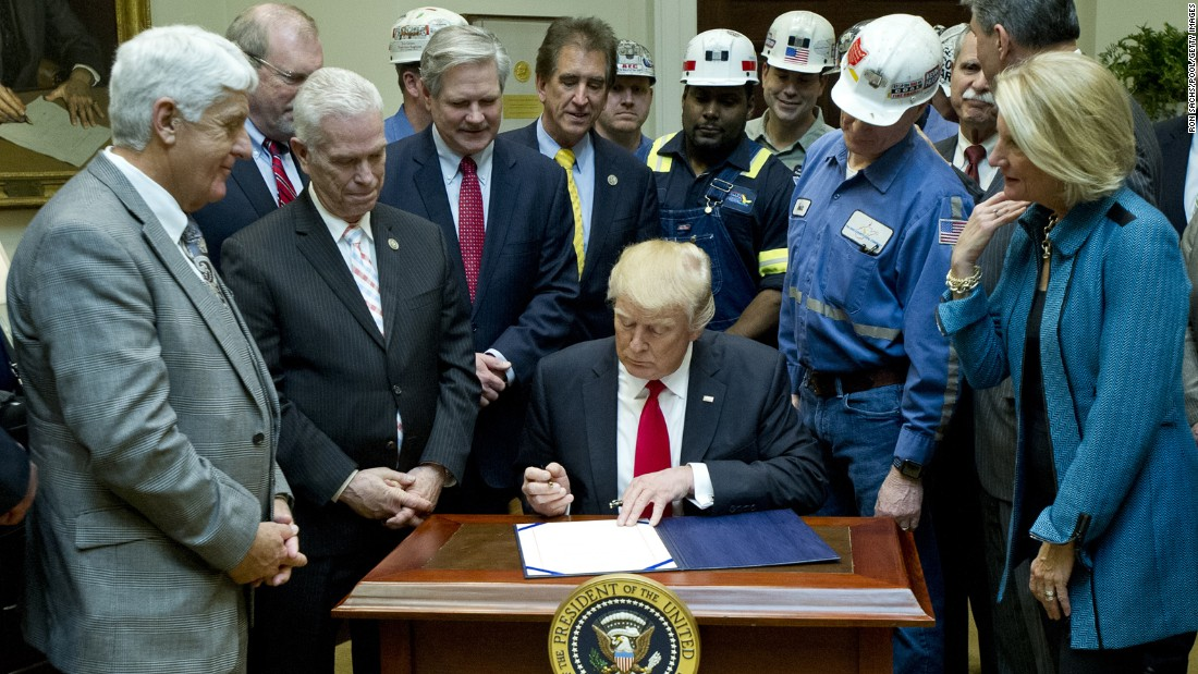 "President Trump signs legislation Thursday, February 16, that rolls back the ""Stream Protection Rule,"" a last-minute Obama administration rule aimed at stopping the coal-mining industry from dumping waste into nearby waterways. Trump called it a ""job-killing rule"" as he was joined at the White House by miners as well as legislators from coal-mining states."