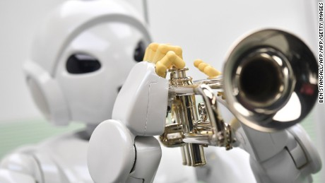 A robot produced by the Toyota Motor Corporation called 'Harry Trumpet -Player Robot' Japan 2005 is on view at the ROBOT exhibition at the Science Museum in London on February 7, 2017. / AFP / BEN STANSALL        (Photo credit should read BEN STANSALL/AFP/Getty Images)