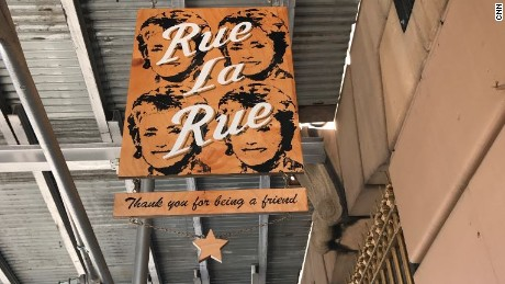 """The sign outside Rue La Rue Café in New York City carries a line from """"The Golden Girls"""" theme song: thank you for being a friend."""
