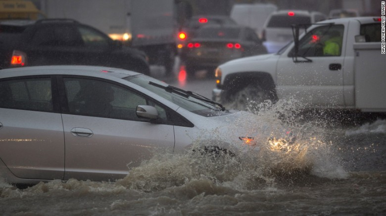 Drivers in Sun Valley, California, navigate flooded streets on Friday.