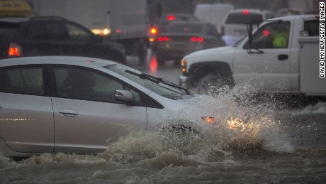 SUN VALLEY, CA - FEBRUARY 17: Motorists ford a flooded street as a powerful storm moves across Southern California on February 17, 2017 in Sun Valley, California. After years of severe drought, heavy winter rains have come to the state, and with them, the issuance of flash flood watches in Santa Barbara, Ventura and Los Angeles counties, and the evacuation of hundreds of residents from Duarte, California for fear of flash flooding from area denuded by a wildfire last year.   (Photo by David McNew/Getty Images)