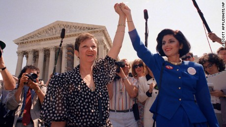 In this 1989 photo, Norma McCorvey, Jane Roe in the 1973 court case, left, and her attorney Gloria Allred hold hands as they leave the Supreme Court building in Washington after sitting in while the court listened to arguments in a Missouri abortion case.