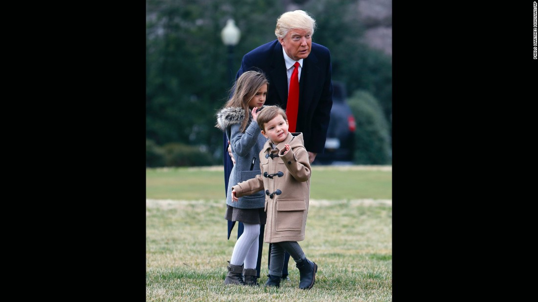 President Donald Trump and his grandchildren, Arabella and Joseph Kushner, walk on the South Lawn of the White House to board Marine One on Friday, February 17.