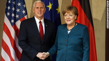 U.S. Vice President Mike Pence and German Chancellor Angela Merkel shake hands at the 2017 Munich Security Conference on February 18, 2017 in Munich, Germany.