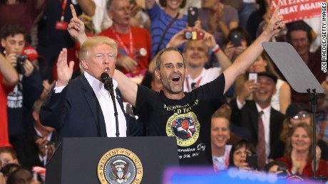 President Donald Trump introduces Gene Huber on stage to speak during a campaign rally at the AeroMod International hangar at Orlando Melbourne International Airport on February 18, 2017 in Melbourne, Florida. President Trump is holding his rally as he continues to try to push his agenda through in Washington, DC.