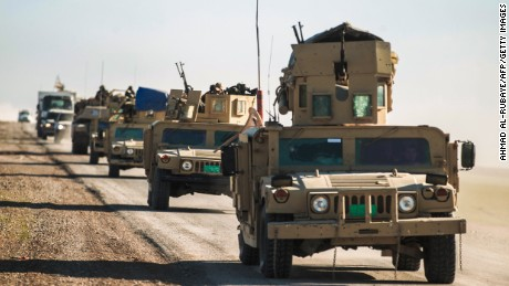 Tanks and armored vehicles of the Iraqi forces, supported by the Hashed al-Shaabi paramilitaries, advance towards the village of Sheikh Younis, south of Mosul, after the offensive to retake the western side of Mosul from Islamic State group fighters commenced on February 19, 2017.