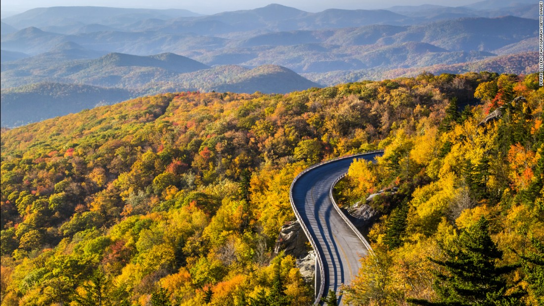 <strong>2. Blue Ridge Parkway, North Carolina/Virginia:</strong> Blue Ridge Parkway meanders for 469 miles through two states, revealing gorgeous views of the Appalachian Highlands that vary incredibly by season. Autumn's changing foliage is evident in a sunrise view of the Linn Cove Viaduct at Milepost 304 in North Carolina.