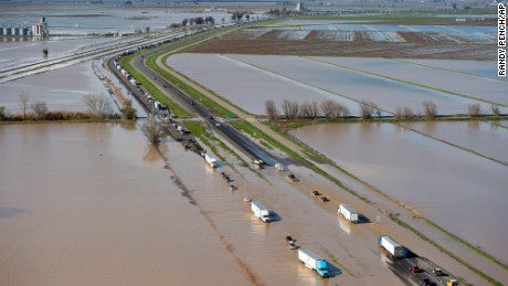 Flood waters cross over Interstate 5 at Williams, California backing up traffic in both north and southbound lanes for hours on Saturday, February 18, 2017.