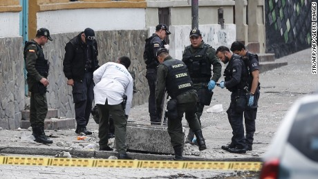 Colombian anti-explosive police inspect the site where a bomb exploded near the La Macarena bullring in downtown Bogota, Colombia, on February 19, 2017.  According to official reports, one policeman was killed and 30 people were injured in the explosion. / AFP / STR        (Photo credit should read STR/AFP/Getty Images)
