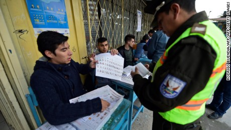 A police officer casts his vote at a polling station in Quito, on February 19, 2017 during general elections. Ecuador's elections will decide who succeeds leftist President Rafael Correa after a decade in power. / AFP / Rodrigo BUENDIA        (Photo credit should read RODRIGO BUENDIA/AFP/Getty Images)