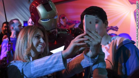 "A Lebanese woman poses for a selfie with a man dressed up as ""Iron Man"" during Saudi Arabia's first ever Comic-Con event in the coastal city of Jeddah on February 16, 2017."