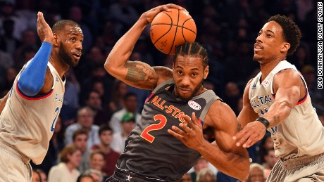 Feb 19, 2017; New Orleans, LA, USA; Western Conference forward Kawhi Leonard of the San Antonio Spurs (2) drives to the basket against  Eastern Conference guard DeMar DeRozan of the Toronto Raptoers (10) and  Eastern Conference forward LeBron James of the Cleveland Cavaliers (23) in the 2017 NBA All-Star Game at Smoothie King Center. Mandatory Credit: Bob Donnan-USA TODAY Sports