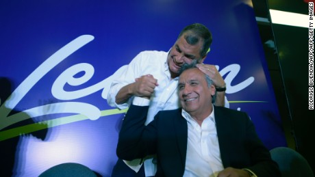 TOPSHOT - Ecuadorian President Rafael Correa (L) hugs Lenin Moreno, the presidential candidate of the governing Alianza PAIS party, at a hotel in Quito after the exit polls indicate that the leftist candidate won the first round of the elections on February 19, 2017.  / AFP / RODRIGO BUENDIA        (Photo credit should read RODRIGO BUENDIA/AFP/Getty Images)