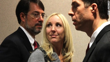 Nicole Oulson and her attorneys Stephen Leal and TJ Grimaldi in a Dade City, Florida court house on January 30, 2014, after a court hearing and appeal for Curtis Reeves, the man accused of fatally shooting and killing her husband Chad Oulson in a movie theatre on January. 13, 2014.