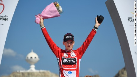 Belgium's Ben Hermans raises his arms in celebration after winning the Tour of Oman.