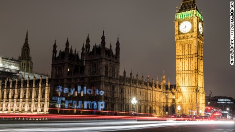LONDON, ENGLAND - FEBRUARY 19:  A slogan reading 'Say no to Trump' is seen projected on the Houses of Parliament, the evening before a parliamentary debate on Donald Trump's state visit is due to take place, on February 19, 2017 in London, England. The British parliament will hold a debate on calls to cancel Donald Trump's state visit, due to be hosted by the Queen Elizabeth II this year, after 1.8 million people signed a petition in support of scrapping or downgrading the invitation. The projection was created by Global Justice Now, a campaign organisation that is part of the Stop Trump Coalition, working alongside guerrilla projectionists Feral X. (Photo by Chris J Ratcliffe/Getty Images)