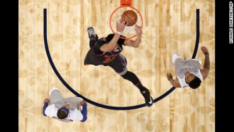Western Conference forward Anthony Davis of the New Orleans Pelicans slam dunks over Eastern Conference forward Carmelo Anthony of the New York Knicks, left, and guard DeMar DeRozan of the Toronto Raptors during the second half of the NBA All-Star basketball game in New Orleans, Sunday, Feb. 19, 2017. (Ronald Martinez/Pool via AP)