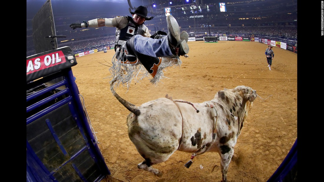 Marco Antonio Eguchi is bucked off Bottoms Up during a Professional Bull Riders event in Arlington, Texas, on Saturday, February 18.