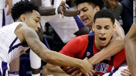 Arizona's Chance Comanche, right, fights for the ball with Washington's David Crisp, left, and Matisse Thybulle during the second half of an NCAA college basketball game Saturday, Feb. 18, 2017, in Seattle. Arizona won 76-68. (AP Photo/Elaine Thompson)