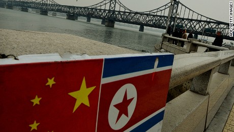 north korea and china flags dandong mark ralston afp getty images