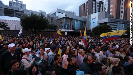 Supporters of Ecuadorean presidential candidate for the CREO party Guillermo Lasso, gather outside the National Electoral Council to wait for for the final results of Sunday's presidential election, in Quito on February 20, 2017. The delay in the release of the results of Sunday's elections generated impatience Monday among opponents to Ecuadorean President Rafael Correa. / AFP / Juan Cevallos        (Photo credit should read JUAN CEVALLOS/AFP/Getty Images)