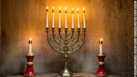 A Menorah on an altar. (Photo by: Loop Images/UIG via Getty Images)