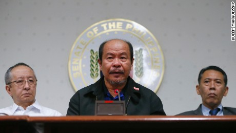 Flanked by lawyers Arno Sanidad, left, and Jose Manuel Diokno, right, retired police officer Arthur Lascanas tells a news conference at the Philippine Senate in suburban Pasay city, south of Manila, Philippines, Monday, Feb. 20, 2017. Lascanas said President Rodrigo Duterte, when he was a city mayor, ordered and paid him and other members of a so-called liquidation squad to kill criminals and opponents, including a kidnapping suspect and his entire family and a critical radio commentator. (AP Photo/Bullit Marquez)