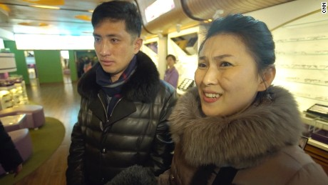 "North Korean housewife Kim Chun Ae, standing with her husband Kim Chol Ryong, says she is not the ""slightest"" interested in who is US president"