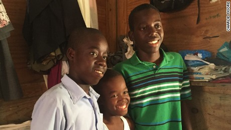 Monley (center) with his brothers Christoper (left) and Moise (right).