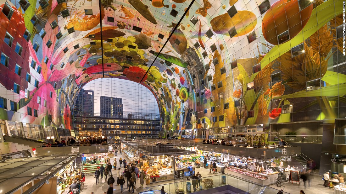 <strong>The world's biggest artwork: </strong>Spanning over 13,000 square yards on the ceiling of the Markthal, the Horn of Plenty by Arno Coenen is the world's largest artwork. It's a painting depicting fruit tumbling from a summer sky, grazing cows and flowers.