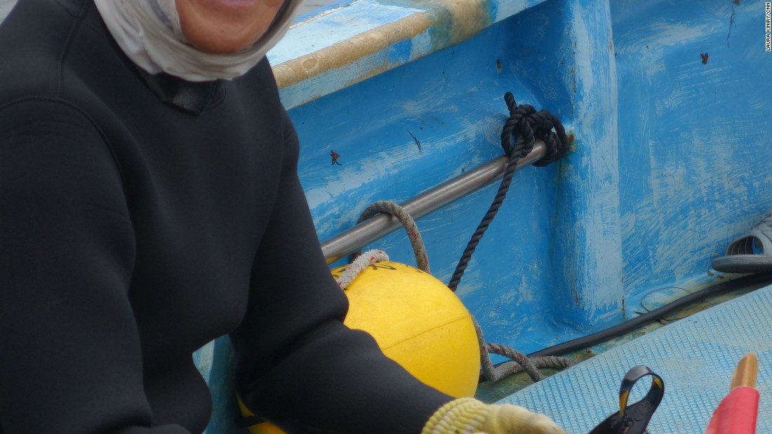 <strong>A dying profession: </strong>Sayuri empties her sukari as the boat heads back to shore. Like her, many ama are in their 60s and have been diving their entire adult lives.