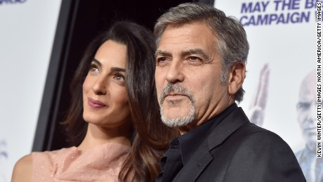 "HOLLYWOOD, CA - OCTOBER 26:  Amal Alamuddin (L) and actor George Clooney attend the premiere of Warner Bros. Pictures' ""Our Brand Is Crisis"" at TCL Chinese Theatre on October 26, 2015 in Hollywood, California.  (Photo by Kevin Winter/Getty Images)"