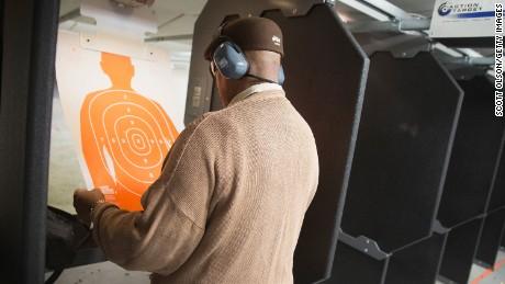A man practices his marksmanship skills at the Metro Shooting Supplies range on Nov. 12, 2014 in Bridgeton, Missouri.