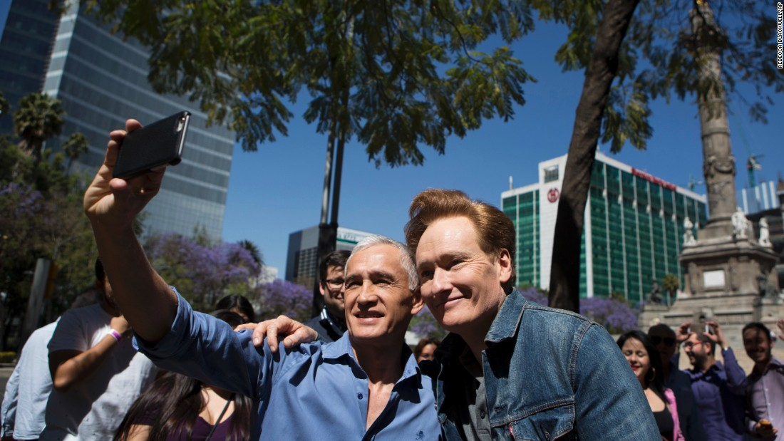 Late-night television host Conan O'Brien poses for a selfie with journalist Jorge Ramos while in Mexico City on Monday, February 20. O'Brien is taping an episode of his show there.