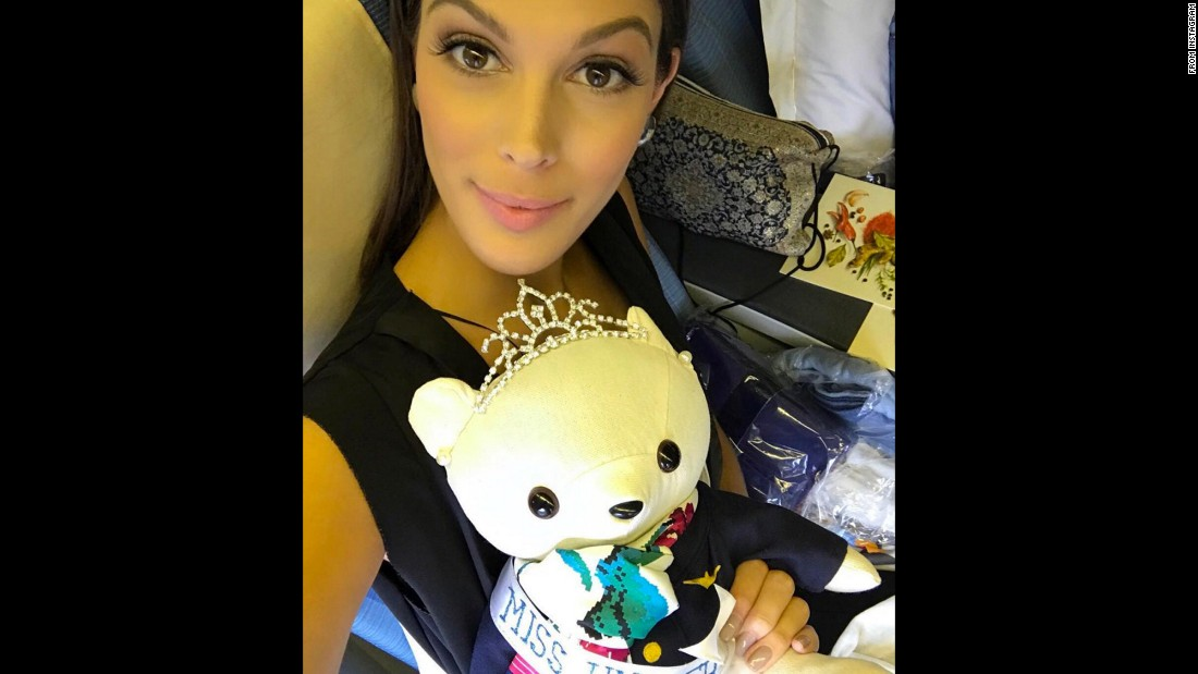 "Miss Universe, Iris Mittenaere, holds a stuffed animal <a href=""https://www.instagram.com/p/BQCyfG9lSVl/"" target=""_blank"">on her way to New York</a> on Friday, February 3."