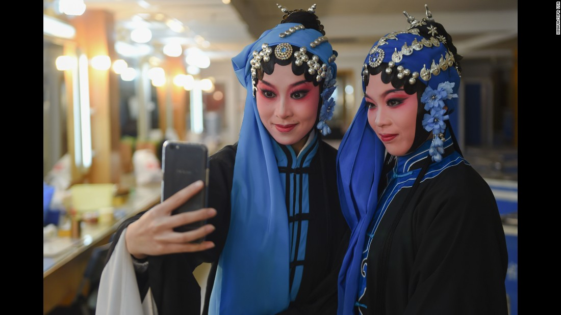 Actresses snap a backstage selfie during an opera competition in Fuzhou, China, on Sunday, February 12.