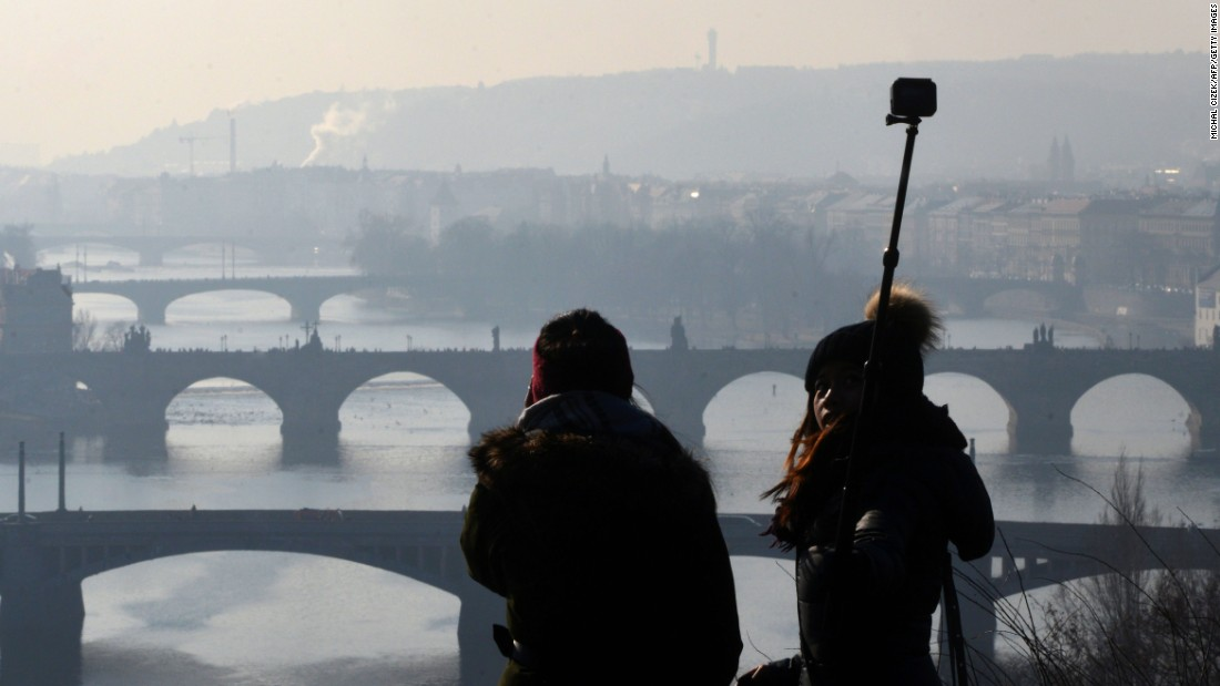 "A woman uses a selfie stick in Prague, Czech Republic, on Monday, February 13. <a href=""http://www.cnn.com/2017/01/25/living/gallery/look-at-me-selfies-january/index.html"" target=""_blank"">Check out January's must-see selfies</a>"