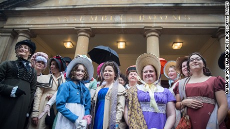 BATH, ENGLAND - SEPTEMBER 10:  Participants gather in front of the Assembly Rooms as they prepare to take part in the annual Jane Austen Regency Costumed Parade as it leaves the Assembly Rooms on September 10, 2016 in Bath, England. The annual event sees hundreds of people parade through city centre streets dressed in regency costume with visitors from all over the world heading to Bath to take part in the event which marks the start of the 10-day Jane Austen festival that celebrates the 19th century author who lived in the city.  (Photo by Matt Cardy/Getty Images)