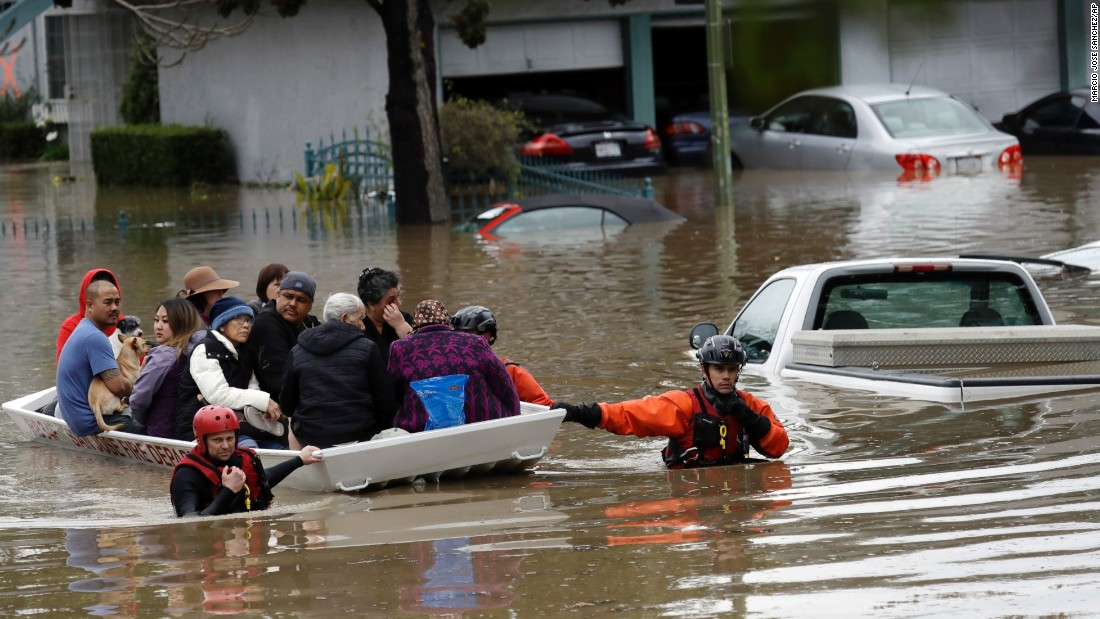 "Rescue crews steer a boat full of residents in a flooded San Jose, California, neighborhood on Tuesday, February 21. <a href=""http://www.cnn.com/2017/02/21/us/san-jose-flood/index.html"" target=""_blank"">One of Southern California's most powerful storms</a> in recent years has caused flooding, power outages and blackouts across the region."
