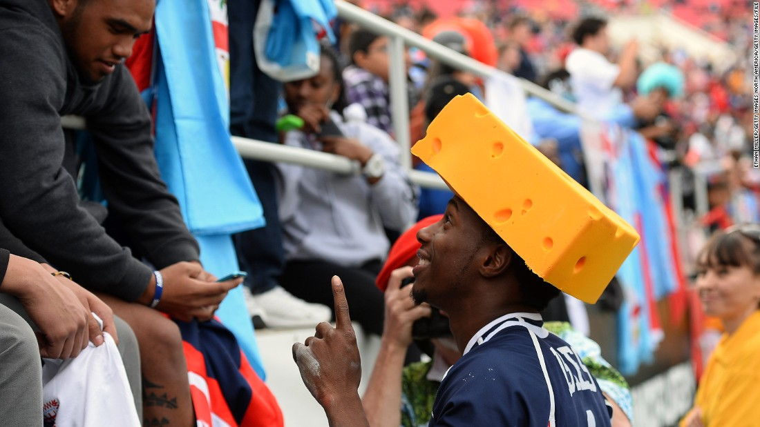 US speedster Carlin Isles is popular with the home supporters. Here he wears a cheese hat at the request of a fan taking his photo after a 2014 game.