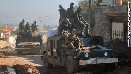 Iraqi security forces taking part in the offensive to retake the western side of Mosul from ISIS  fighters move through the village of al-Buseif on Tuesday.