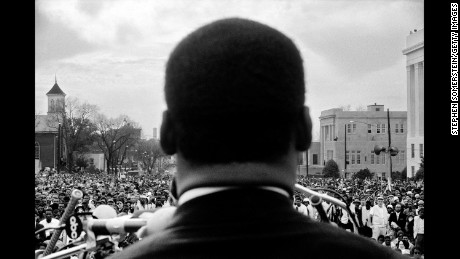 MONTGOMERY- MARCH 25:  Dr. Martin Luther King, Jr. seen close from the rear, speaking in front of 25,000 civil rights marchers, at the conclusion of the Selma to Montgomery march in front of Alabama state capital building on March 25, 1965. In Montgomery, Alabama. (Photo by Stephen Somerstein/Getty Images)