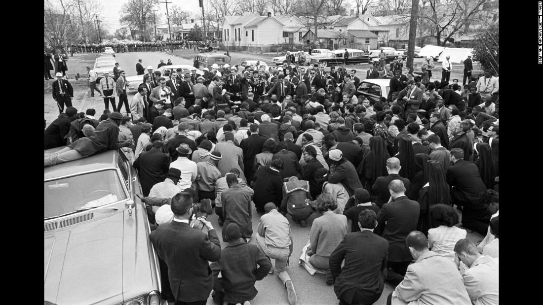 Marchers kneel in prayer after being stopped by state troopers in Selma.