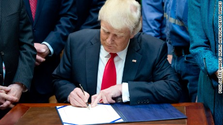 "WASHINGTON, DC - FEBRUARY 16:  U.S. President Donald Trump signs H.J. Res. 38, disapproving the rule submitted by the US Department of the Interior known as the Stream Protection Rule in the Roosevelt Room of the White House on February 16, 2017 in Washington, DC.  The Department of Interior's Stream Protection Rule, which was signed during the final month of the Obama administration, ""addresses the impacts of surface coal mining operations on surface water, groundwater, and the productivity of mining operation sites,"" according to the Congress.gov summary of the resolution. (Photo by Ron Sachs-Pool/Getty Images)"